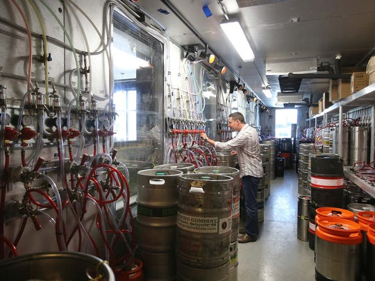 Owner Mark Sellers is seen in the beer keg room where brew from over a hundred barrels is sent to the taps. This is a photo Wednesday August 13, 2014 from HopCat, a new brew pub opening in Broad Ripple.