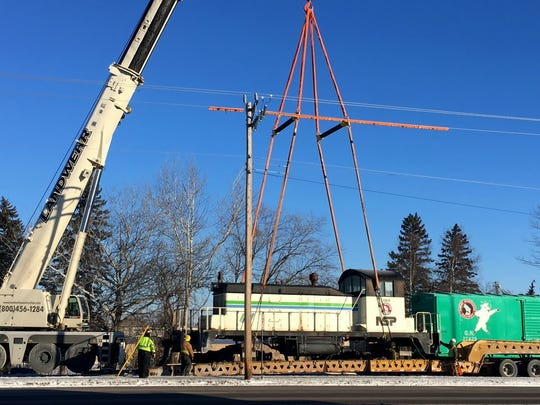 On Saturday, Jan. 13, a crew used a large crane install a 79-year-old, 99-ton diesel locomotive on display train tracks in Waite Park.