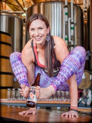 Mikki Trowbridge, the founder of Yoga + Beer, in a yoga pose at a brewery.