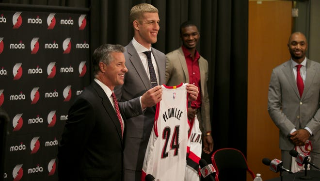 The Portland Trail Blazers general manager Neil Olshey, left, poses for a photo with Mason Plumlee during a news conference Monday, June 29, 2015, in Portland, Ore. New Blazers Noah Vonleh, Mason Plumlee and Henderson were introduced during the new conference.