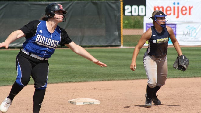 Indian River Inland Lakes' Cloe Mallory slows down rounding second base as Ottawa Lake Whiteford's Milly Iott defends second base during the Division 4 state final Saturday in East Lansing.
