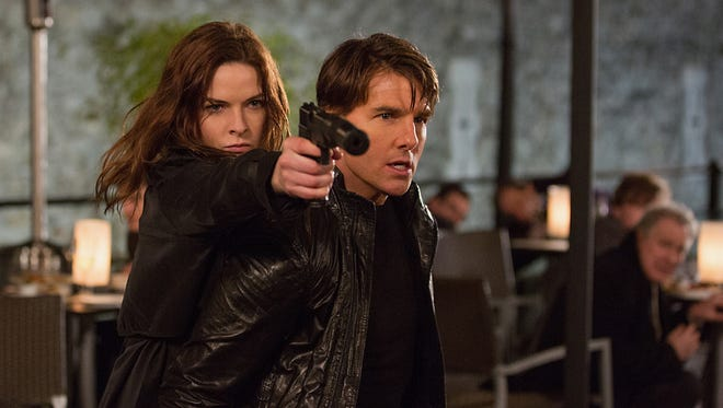 Rebecca Ferguson, left, and Tom Cruise in 'Mission: Impossible — Rogue Nation.' The fifth installment in the series made its debut at No. 1 at the box office.