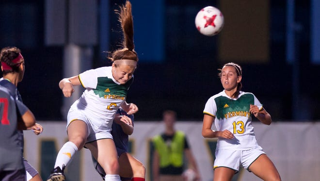 University of Vermont midfielder Angie Salvi, left heads in a goal off of a corner kick during the second half of Friday night's game against Sacred Heart at Virtue Field.