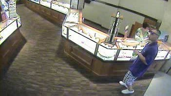 Security camera footage of suspect in Bay Park Square Zales robbery on June 29.