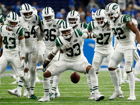 New York Jets defensive back Jamal Adams (33) celebrates his interception with teammates during the second half of an NFL football game against the Detroit Lions in Detroit, Monday, Sept. 10, 2018. (AP Photo/Rick Osentoski)