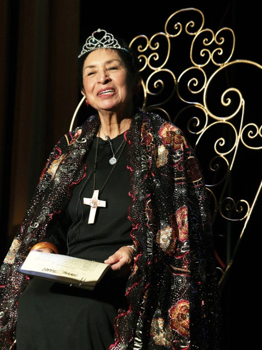 Rosa Guerrero dons a crown and sits in a royal chair on Saturday for her birthday.