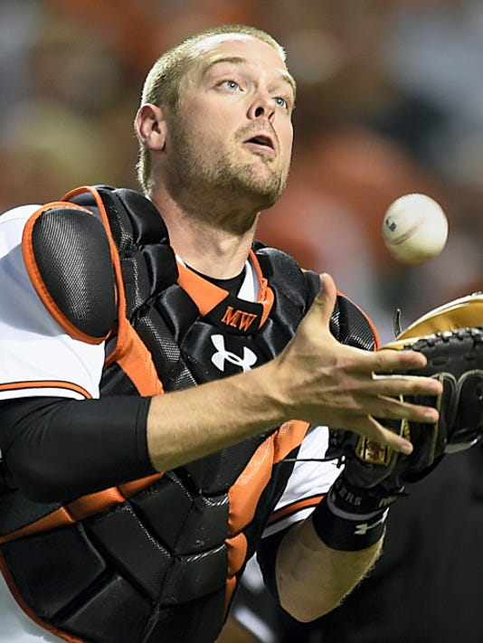 Baltimore catcher Matt Wieters catches a foul ball hit by Texas' Elvis Andrus in the sixth inning on Tuesday in Baltimore. (AP Photo/Gail Burton)