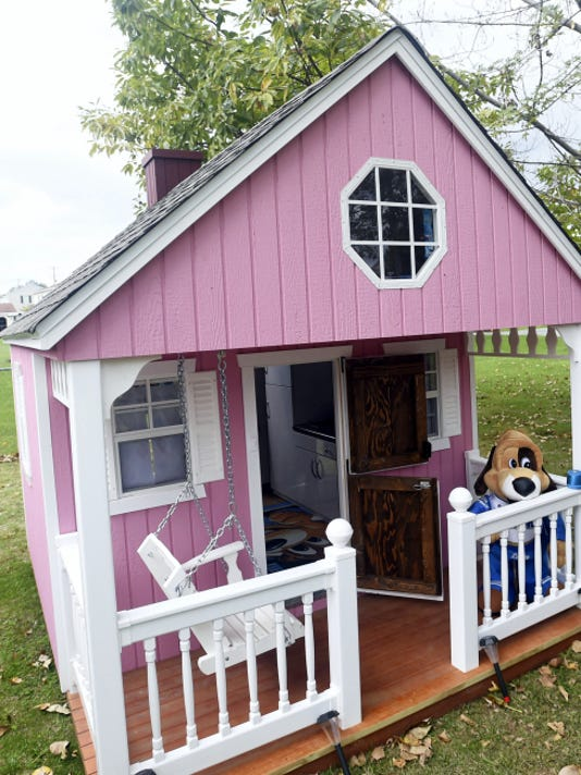 Emily Schmidt, 5, a cancer patient, receives an outdoor playhouse from Make-A-Wish Foundation on Saturday. Various companies donated their time and materials to build the playhouse of Emily's dreams, based on specs she provided.