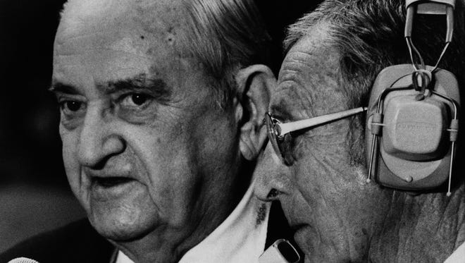 Retired Kentucky Wildcat head coach Adolph Rupp left, talks with former UCLA head coach John Wooden as the two met between games in the NCAA Mideast regional tourney March 18, 1977in Rupp Arena in Lexington. (AP Photo)