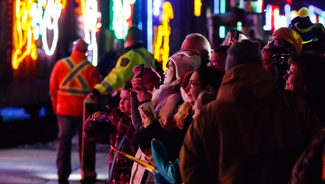 Visitors watch with anticipation as the Canadian Pacific Holiday Train rolls into Oconomowoc on Sunday, Dec. 3, 2017. The Holiday Train tours Canada and the United States raising money, food and awareness for people in need.