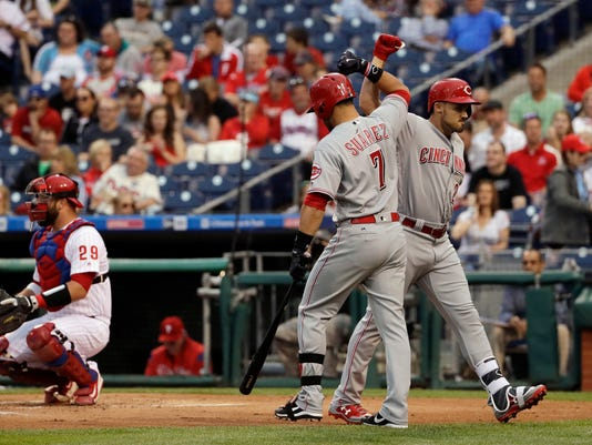 Cincinnati Reds' Adam Duvall, right, and Eugenio Suarez, center, celebrate past Philadelphia Phillies catcher Cameron Rupp after Duvall's home run during the first inning of a baseball game, Friday, May 26, 2017, in Philadelphia. (AP Photo/Matt Slocum)