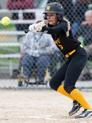 Waupun High School Softball's Megan Gerber bunts a pitch against Winneconne in the second game of a doubleheader Tuesday, May 9, 2017. Waupun won both games 5-2 and 9-2.