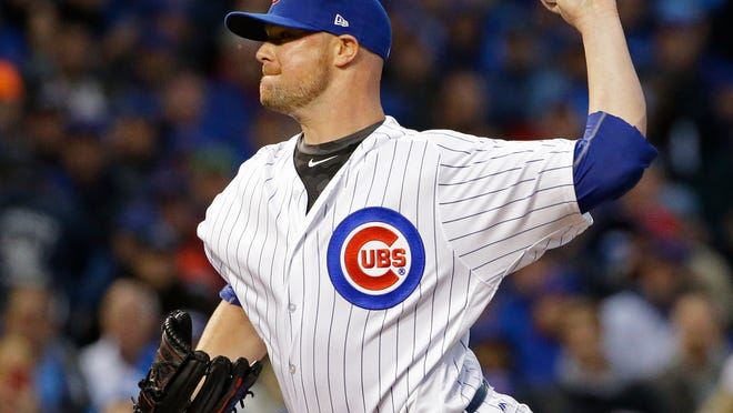 Chicago Cubs' Jon Lester throws during the fifth inning of Game 4 of baseball's National League Division Series against the Washington Nationals, Wednesday, Oct. 11, 2017, in Chicago. (AP Photo/Nam Y. Huh)