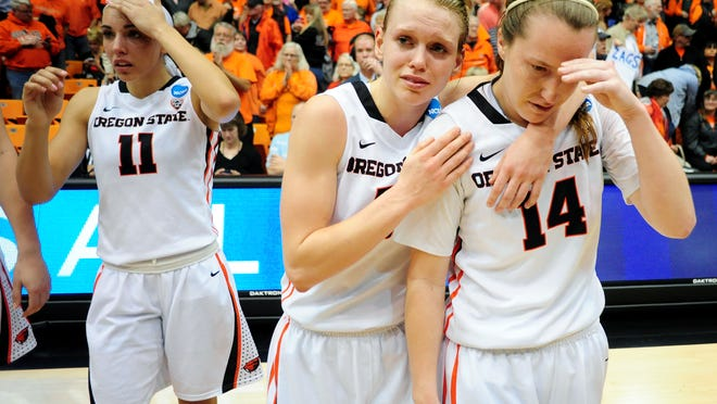 Oregon State guard Jamie Weisner consoles teammate Ali Gibson, right, following their 76-64 loss against Gonzaga on Sunday, March 22, during the second round of the NCAA women's basketball tournament in Corvallis.