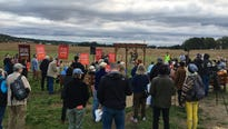 Protesters at a pipeline construction site near a nuns' chapel in Lancaster County surrounded an excavator and sang songs, and then were told to leave by police.
