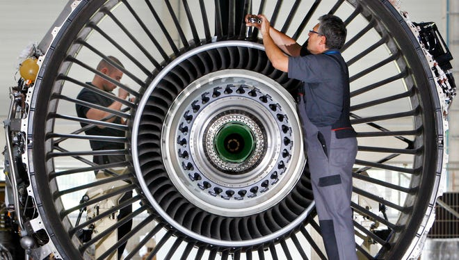 Jet engine mechanics work in a joint-venture maintenance facility run by Lufthansa and Rolls Royce in Arnstadt, Germany.