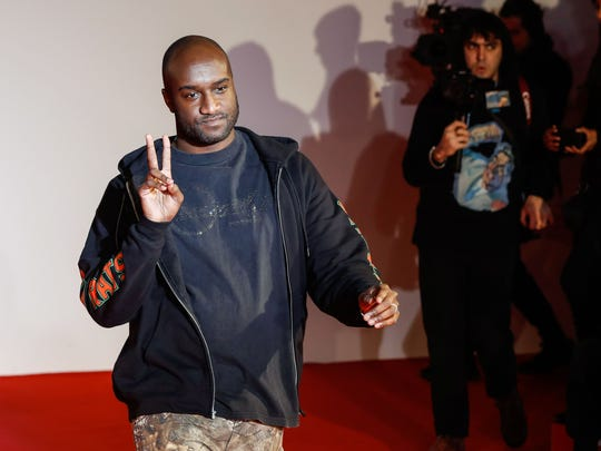 U.S. fashion designer Virgil Abloh acknowledges applause following the presentation of the men's fall/winter 2018/2019 collection he designed for Off White in Paris.