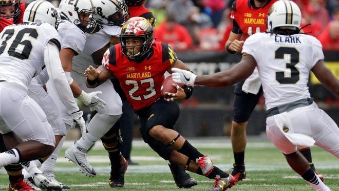 Maryland running back Lorenzo Harrison (23) runs through Purdue defenders for a touchdown in the first half of an NCAA college football game in College Park, Md., Saturday, Oct. 1, 2016. (AP Photo/Patrick Semansky)