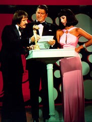 Sonny Bono, left, with Ronald Regan and Cher, on the