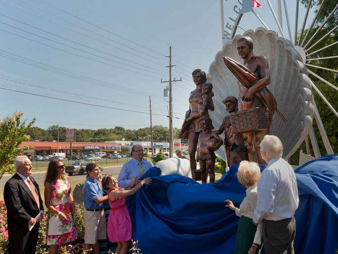 Cover is pulled back during unveiling of Welcome To Ocean County Monument on August 14, 2014 in Toms River. Monument represents all the residents of Ocean County and was created by sculptor Brian P. Hanlon and donated by the Jay & Linda Grunin Foundation.  - Peter Ackerman / Staff Photographer