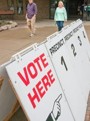 Plymouth voters leave the Cultural Center, the polling place for the city's four precincts, Tuesday.