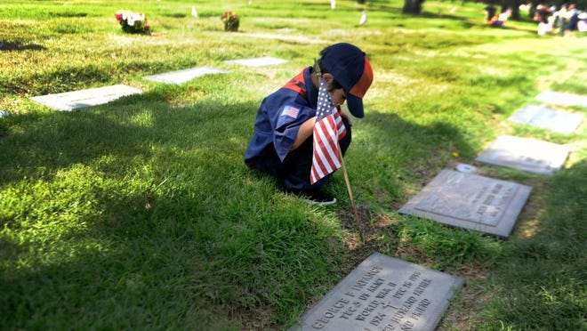 Boy Scouts place flags on graves at Pierce Brothers Valley-Oaks-Griffin Memorial Park in Westlake Village to celebrate Memorial Day each year.