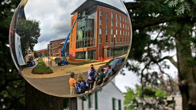 Residence Hall A of the Core Campus dormitories, across Fort Hill Street from the Calhoun Mansion, is seen in a mirror set up for cars entering the road. The newly built 260,000-square-foot Core Campus Project houses nearly 700 honors students and freshmen.