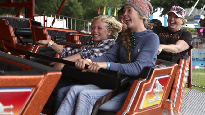Emma Welch, 10, from left, her sister, Kimber, 14, mom, Shawna, and great-aunt, Sandy Palmer go for a ride during the 2016 Shasta District Fair.