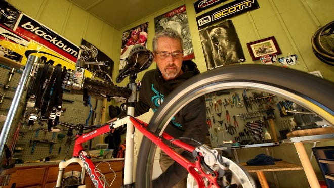 Kitsap Sun file photo Kelly Campo's passion for cycling led him to start a small business, Night Owl Cycling. Maintaining time for himself to ride is key as owner.