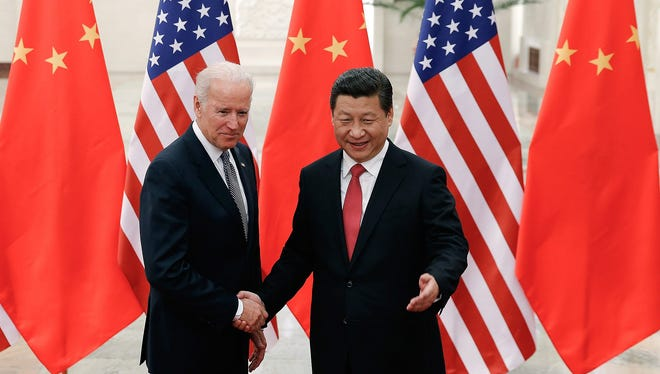 As vice president in 2013, Joe Biden met with Chinese President Xi Jinping at the Great Hall of the People in Beijing.