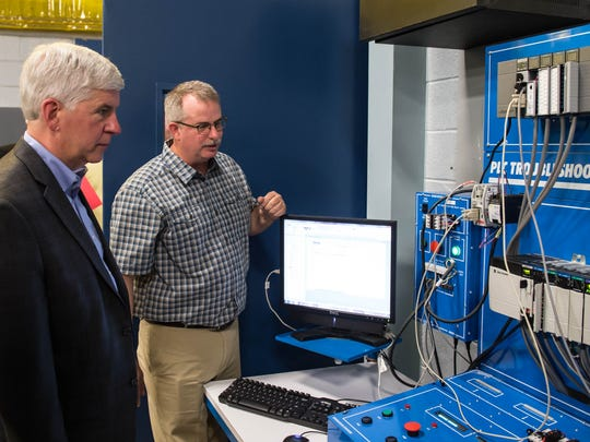 Kellogg Community College Regional Manufacturing Technology Center instructor Kevin Barnes demonstrates a PLC Trouble Shooting System to Gov. Rick Snyder during a tour on Thursday.