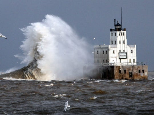 Waves pummel the lighthouse on Lake Michigan in December,