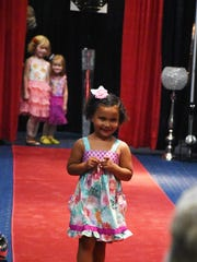 Even the youngest models had fun walking the red carpet at the Niche Boutique fashion show, May, 2017.