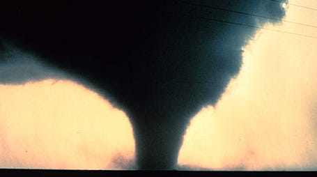 An F2 tornado roars near Seymour, Texas, in April 1979. One physicist thinks tornadoes can be stopped by building giant walls in the central U.S.