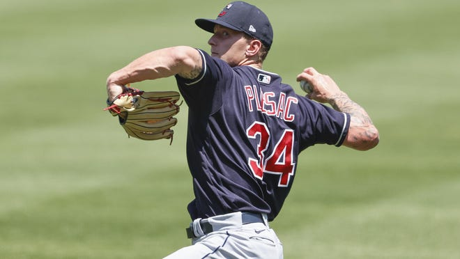 Cleveland Indians pitcher Zach Plesac throws during baseball practice at Progressive Field, Monday, July 6, 2020, in Cleveland.