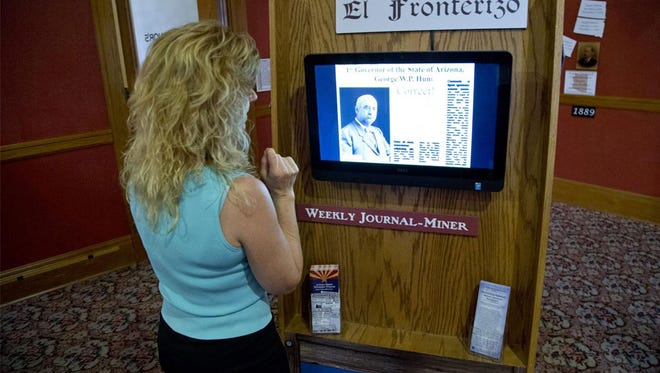 """Project manager Eden Robins explores the """"Arizona History at Your Finger Tips"""" exhibit that opened Saturday at the Arizona Capitol Museum."""
