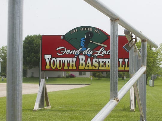 A pad-locked gate keeps players and spectators from entering the Fond du Lac Youth Baseball Complex off of Fourth Street.
