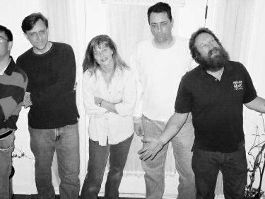 The members of Green Shoes Does It have been playing together in various combinations of bands for almost 30 years. If you ve ever seen Matriarch, Large Marge, Bear Essentials or Third Stone, you ve seen at least a couple of these guys. From left to right: Earl Duzey, Scott Shuster, Amy Boll, Rich Shuster, Darin Green.