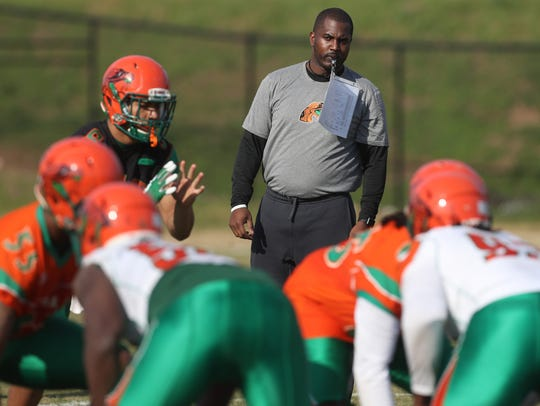 FAMU Head Coach Willie Simmons watches as his players
