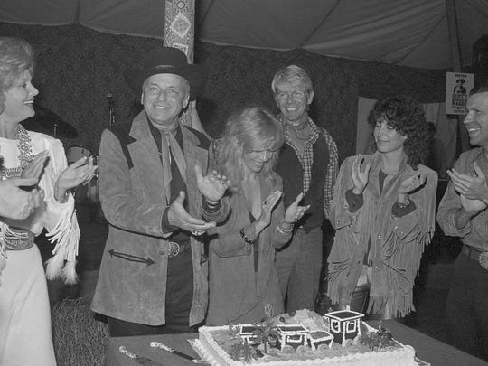 Entertainer Frank Sinatra, second from left, joins