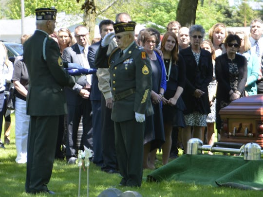 The American flag is presented to the next of kin at a military funeral held in Two Rivers.