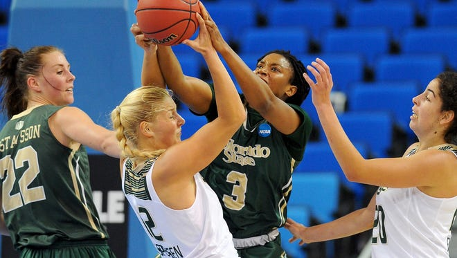 Colorado State's Keyora Wharry (3) and South Florida's Maria Jespersen, center left, battle for a rebound during a first-round women's college basketball game in the NCAA Tournament in Los Angeles, Saturday, March 19, 2016. (AP Photo/Michael Owen Baker)
