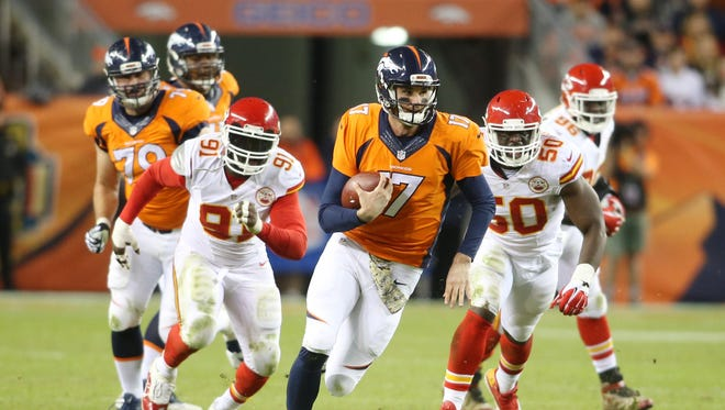 Denver Broncos quarterback Brock Osweiler (17) runs the ball during the second half against the Kansas City Chiefs at Sports Authority Field at Mile High. The Chiefs won 29-13.