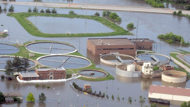 Floodwaters surround the old Iowa City water treatment plant on Sunday morning, June 15, 2008.