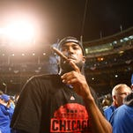Chicago Cubs center fielder Dexter Fowler (24) celebrates after defeating the St. Louis Cardinals in game four of the NLDS at Wrigley Field.