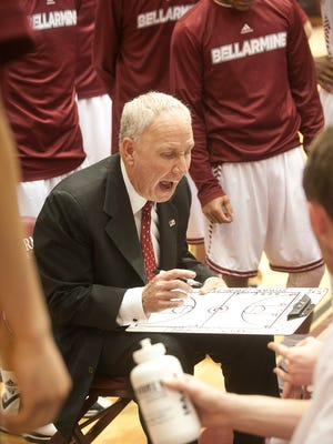 Bellarmine University Knights head basketball coach Scott Davenport draws a play during a time-out.17 March 2015