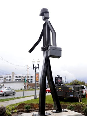 """The structural steel statue """"The Worker"""" is freshly up at Cedar and Shiawassee streets in Lansing."""