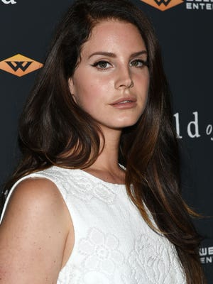 "Lana Del Rey attends the ""Child Of God"" premiere at Tribeca Grand Hotel on July 30, 2014 in New York. Her new album, 'Honeymoon,' is out now."