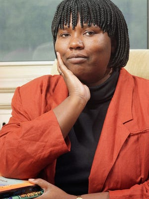 In this Oct. 9, 1992 file photo, Gloria Naylor, author of 'The Women of Brewster Place,' poses at her home in New York.