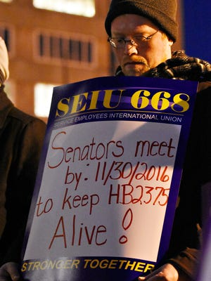 The Harrisburg #Savethe600 Unemployment Compensation Workers Rally is held outside the Labor and Industry Building in Harrisburg, Monday, Nov. 28, 2016. Dawn J. Sagert photo